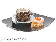 Купить «Оригинально декорированная чашка с горячим кофе,бутерброд с красной икрой», фото № 767183, снято 2 января 2009 г. (c) Vitas / Фотобанк Лори