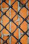 Кованая железная решётка на фоне кирпичной стены, фото № 771787, снято 5 марта 2009 г. (c) Михаил Михин / Фотобанк Лори