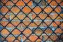 Кованая железная решётка на фоне кирпичной стены, фото № 771803, снято 5 марта 2009 г. (c) Михаил Михин / Фотобанк Лори
