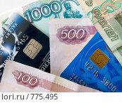 Купить «Банковские карты и банкноты 100, 500, 1000 рублей», фото № 775495, снято 28 марта 2009 г. (c) Кирпинев Валерий / Фотобанк Лори