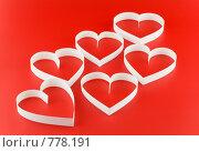 Сердца на красном фоне. Стоковое фото, фотограф Vitas / Фотобанк Лори