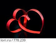 Купить «Красные сердца на черном фоне», фото № 778239, снято 23 января 2009 г. (c) Vitas / Фотобанк Лори