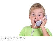 Купить «Ребенок, говорящий по телефону», фото № 778715, снято 18 июля 2018 г. (c) Losevsky Pavel / Фотобанк Лори