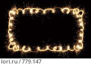 Купить «Рамка из искр в виде спиралей», фото № 779147, снято 16 декабря 2018 г. (c) Losevsky Pavel / Фотобанк Лори