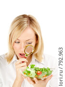 Купить «Девушка рассматривает овощи», фото № 792963, снято 14 октября 2008 г. (c) Raev Denis / Фотобанк Лори