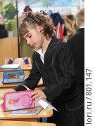 Купить «Первоклассница стоит у парты», фото № 801147, снято 7 апреля 2009 г. (c) Федор Королевский / Фотобанк Лори
