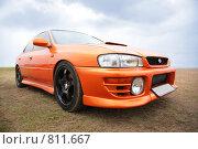 Купить «Оранжевый спортивный автомобиль», фото № 811667, снято 16 октября 2018 г. (c) Losevsky Pavel / Фотобанк Лори