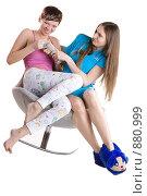 Купить «Две девушки спорят из-за пульта от телевизора», фото № 880999, снято 26 марта 2009 г. (c) Кувшинников Павел / Фотобанк Лори