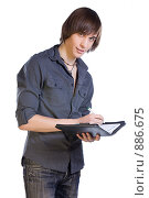 Молодой человек пишет в записной книжке. Стоковое фото, фотограф Кувшинников Павел / Фотобанк Лори