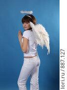 Купить «Портрет девушки в костюме ангела», фото № 887127, снято 3 мая 2009 г. (c) Евгений Батраков / Фотобанк Лори