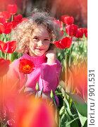 Купить «Девочка с тюльпанами», фото № 901531, снято 9 мая 2009 г. (c) Майя Крученкова / Фотобанк Лори