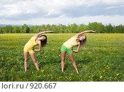 Купить «Две девушки делают зарядку в цветущем поле», фото № 920667, снято 14 июня 2009 г. (c) Ирина Игумнова / Фотобанк Лори