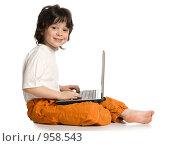 Купить «Мальчик с ноутбуком», фото № 958543, снято 20 июня 2009 г. (c) Григорьева Любовь / Фотобанк Лори
