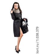 Купить «Девушка в пальто», фото № 1038379, снято 18 сентября 2008 г. (c) Сергей Сухоруков / Фотобанк Лори