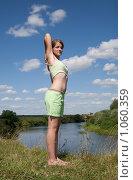 Купить «Девушка занимается гимнастикой», фото № 1060359, снято 19 июля 2009 г. (c) Яков Филимонов / Фотобанк Лори