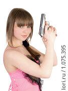 Купить «Девушка в розовом платье с пистолетом», фото № 1075395, снято 26 февраля 2009 г. (c) Сергей Сухоруков / Фотобанк Лори
