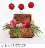 Купить «Новогодняя корзина с игрушками, елью и подарками», фото № 1077051, снято 3 сентября 2009 г. (c) Гараев Александр / Фотобанк Лори
