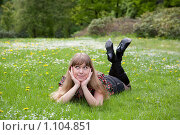 Купить «Девушка лежит на лугу», фото № 1104851, снято 20 мая 2009 г. (c) Сергей Шумаков / Фотобанк Лори