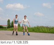 Купить «Две двеушки на роликах», фото № 1128335, снято 14 июня 2009 г. (c) Яков Филимонов / Фотобанк Лори