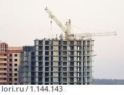 Стройка многоэтажного жилого дома. Стоковое фото, фотограф Иван Новиков / Фотобанк Лори