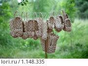 Купить «Плетеные лапти и корзинка», фото № 1148335, снято 6 августа 2009 г. (c) Gagara / Фотобанк Лори