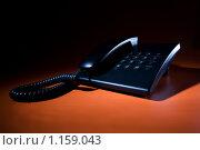 Телефон на оранжевом фоне. Стоковое фото, фотограф Тимур Аникин / Фотобанк Лори