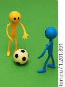 Купить «Два смайлика играют в футбол на зеленом поле», фото № 1201891, снято 27 мая 2007 г. (c) Elnur / Фотобанк Лори