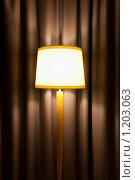 Купить «Торшер на фоне плотных штор», фото № 1203063, снято 13 октября 2009 г. (c) Константин Ёлшин / Фотобанк Лори