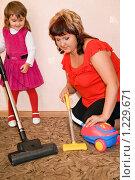 Купить «Девочка помогает маме пылесосить ковер», фото № 1229671, снято 28 сентября 2009 г. (c) Losevsky Pavel / Фотобанк Лори