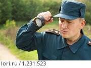 Купить «Военный с фонариком», фото № 1231523, снято 17 сентября 2009 г. (c) Losevsky Pavel / Фотобанк Лори