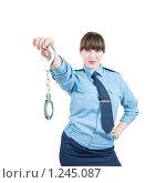 Купить «Девушка-милиционер с наручниками», фото № 1245087, снято 15 ноября 2009 г. (c) Яков Филимонов / Фотобанк Лори