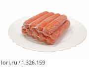 Купить «Замороженные сосиски в упаковке на тарелке,изолировано», фото № 1326159, снято 27 декабря 2009 г. (c) Глазков Владимир / Фотобанк Лори