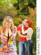 Купить «Плачущая девушка и целующаяся молодая пара на заднем плане», фото № 1382027, снято 30 сентября 2007 г. (c) Andrejs Pidjass / Фотобанк Лори