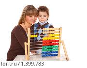 Купить «Мама и сын на белом фоне», эксклюзивное фото № 1399783, снято 12 ноября 2009 г. (c) Juliya Shumskaya / Blue Bear Studio / Фотобанк Лори