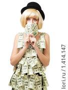 Купить «Шокированная девушка в платье из денег», фото № 1414147, снято 12 декабря 2009 г. (c) Сергей Новиков / Фотобанк Лори