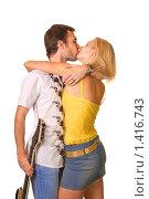 Купить «Парень с гитарой целует и обнимает девушку», фото № 1416743, снято 29 июля 2007 г. (c) Andrejs Pidjass / Фотобанк Лори