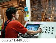 Купить «Оператор на фабрике», фото № 1440335, снято 30 мая 2009 г. (c) Andrejs Pidjass / Фотобанк Лори