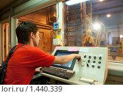 Купить «Оператор на фабрике», фото № 1440339, снято 30 мая 2009 г. (c) Andrejs Pidjass / Фотобанк Лори