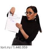 Девушка в очках, с удивлением указывающая пальцем на строку бухгалтерского документа, на белом фоне. Стоковое фото, фотограф Михаил Пименов / Фотобанк Лори