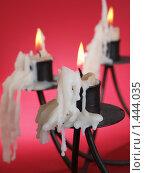 Купить «Яркие свечи в подсвечниках», фото № 1444035, снято 3 января 2010 г. (c) Александр Кузовлев / Фотобанк Лори