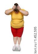 Купить «Женщина с ожирением на весах», фото № 1452595, снято 15 ноября 2009 г. (c) Михаил Коханчиков / Фотобанк Лори