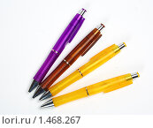 Четыре ручки на белом фоне. Стоковое фото, фотограф Владимир Зорин / Фотобанк Лори