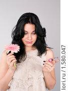 Купить «Девушка сравнивает запах духов и цветка», фото № 1580047, снято 3 марта 2010 г. (c) Okssi / Фотобанк Лори