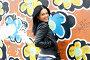 Девушка у стены с граффити, фото № 1635419, снято 17 апреля 2010 г. (c) Ткачёва Ольга / Фотобанк Лори