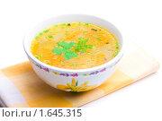 Купить «Куриный суп на желтой салфетке», фото № 1645315, снято 19 апреля 2010 г. (c) Андрей Лавренов / Фотобанк Лори