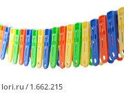 Купить «Цветные прищепки для белья», фото № 1662215, снято 11 апреля 2010 г. (c) Сергей Новиков / Фотобанк Лори