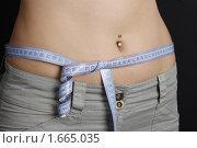 Купить «Талия с сантиметром», фото № 1665035, снято 20 марта 2010 г. (c) Корчагина Полина / Фотобанк Лори