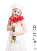 Купить «Девочка с букетом тюльпанов», фото № 1681023, снято 3 мая 2010 г. (c) Майя Крученкова / Фотобанк Лори