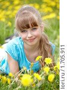 Купить «Девочка в поле с одуванчиками», фото № 1705911, снято 10 мая 2010 г. (c) Gennadiy Poznyakov / Фотобанк Лори