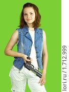 Купить «Девушка с пистолетом», фото № 1712999, снято 12 мая 2010 г. (c) Яков Филимонов / Фотобанк Лори